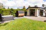 4-person cottage Comfort Wellness jacuzzi + sauna in garden